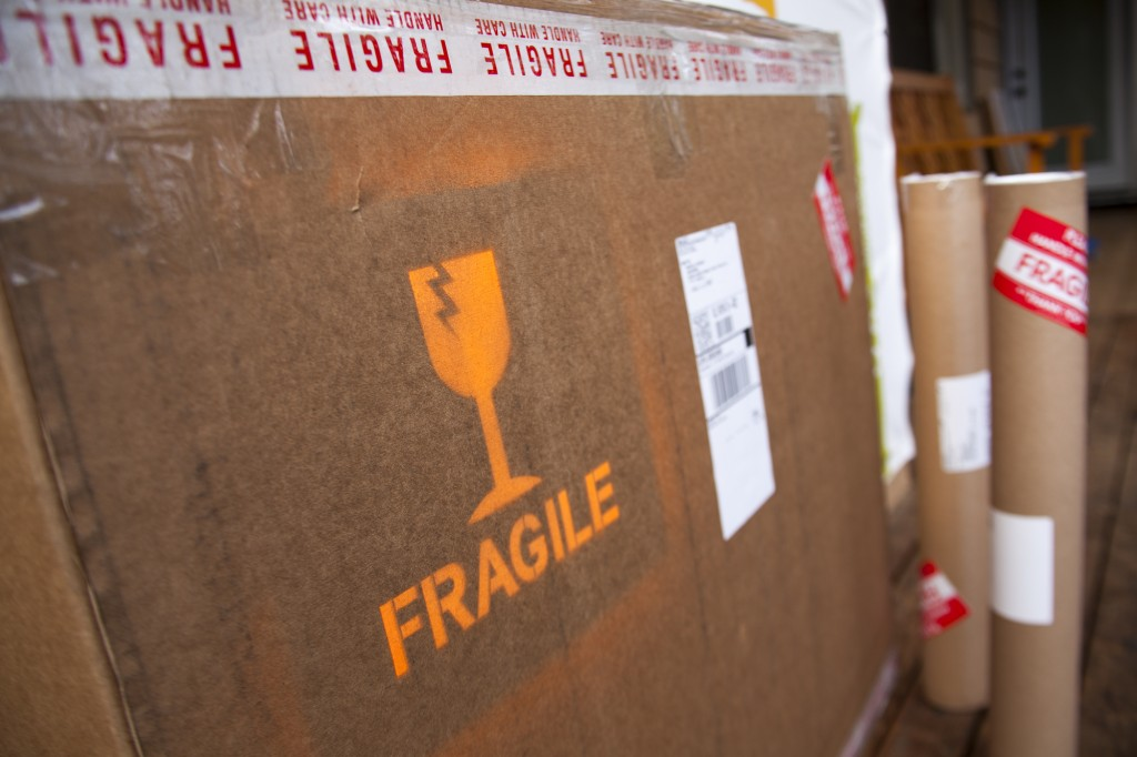 "Large Shipping box with custom ""Fragile"" labels ready for pickup"